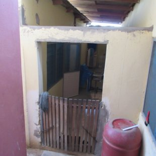 View of the hallway to rooms and bathroom